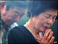 People offer early morning prayers before the start of the 60th anniversary of the atomic bombing at Hiroshima Peace Memorial Park in Hiroshima