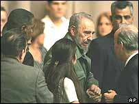 Cuban leader Fidel Castro during his first walk in public since fracturing his knee in October