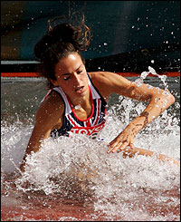 Jo Ankier trips up going over the water jump in the 3,000m steeplechase