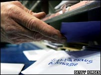 Post officer worker sorting mail