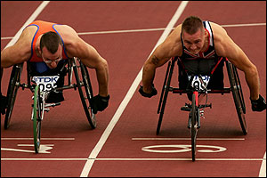 Kenny van Weeghel is just edged out by David Weir in the 100m wheelchair event