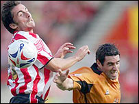 David Prutton and Mark Kennedy battle for possession