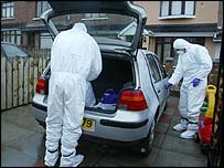 Police searching a car in north Belfast