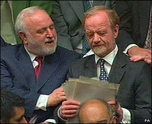 Robin Cook with Labour MP Frank Dobson (left) after making his resignation speech