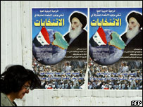 A poster bearing the image of Ayatollah Sistani