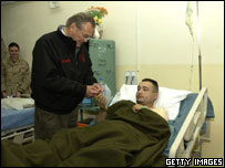 Donald Rumsfeld visits injured soldier at base hospital in Mosul