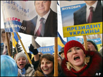 Supporters of Ukrainian Prime Minister Viktor Yanukovych hold portraits of him at the central square in Makeevka, eastern Ukraine