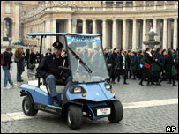 Italian policemen driving a new Lamborghini patrol car in St Peter's Square, Rome