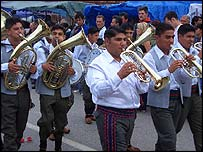 A band parades through the streets of Guca