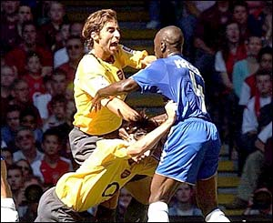 Arsenal's Mathieu Flamini clashes with Chelsea's Claude Makelele