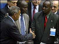 Government representative Yaya Hussein Babikar (left) and SPLA delegate Nhial Deng Nhial exchange documents