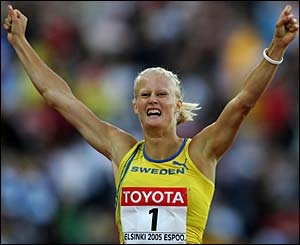 Carolina Kluft celebrates after retaining her heptathlon title