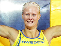 Sweden's Carolina Kluft celebrates her heptathlon gold