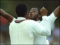 Courtney Walsh celebrates the dismissal of Craig McDermott in Adelaide