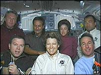 The crew aboard the space shuttle Discovery