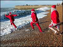 Swimmers dressed as Father Christmas take a dip in Brighton