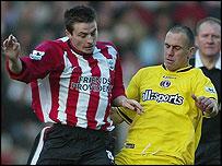 Southampton's Matt Oakley challenges Radostin Kishishev