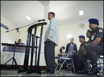 Cheam Channy stands in the dock at the start of his trial at the Military Court in Phnom Penh Monday Aug. 8, 2005.