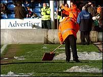 Ice is cleared from the side of the Selhurst Park pitch