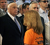 Ariel Sharon eyes a young woman wearing colour of anti-disengagement protesters