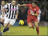 West Brom defender Darren Purse (left) races for possession against Liverpool striker Milan Baros