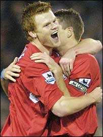 John Arne Riise celebrates scoring Liverpool's opener with goal provider Steven Gerrard