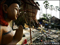 A Buddha statue stands amongst the devastation in Phuket, Thailand