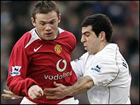Rooney (left) is challenged by Ben Haim during the game