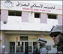 Party offices in Falluja with US soldiers on patrol outside