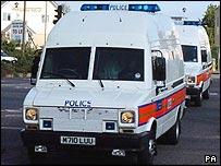 Police vans arriving at court