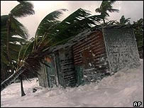 House is flooded by the sea on the coast of La Ceiba, Honduras, in October 1998