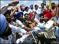 Members of Sikh Students Federation beat an effigy of Congress minister in Amritsar, India