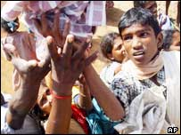 Survivors in India wait for clothes from aid workers