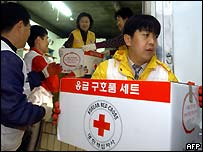 South Korean Red Cross volunteers prepare aid supply kits in Suwon, south of Seoul