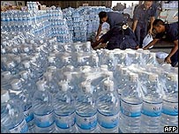 Thai soldiers arrange packs of drinking water