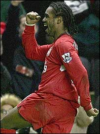 Florent Sinama Pongolle celebrates his goal for Liverpool