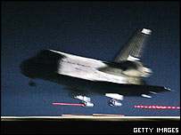 Shuttle lands at Edwards Air Force Base, Getty