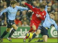 Southampton duo Martin Cranie (left) and Rory Delap close down Liverpool's Luis Garcia