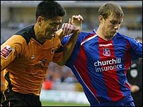Wolves striker Ki-Hyeon Seol tussles with Palace defender Gary Borrowdale