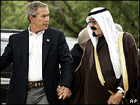 George Bush and King Abdullah hold hands during a meeting at Crawford, Texas
