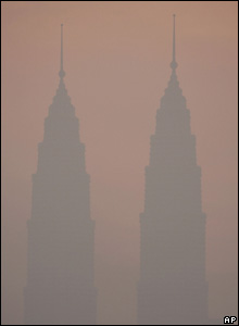 Thick haze covers the city of Malaysia's landmark Petronas Twin Towers, Saturday, 6 Aug, 2005.