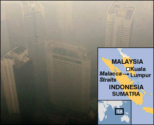 Malaysia's capital city of Kuala Lumpur is cloaked with the thick hazy skylines in the view from Kuala Lumpur Tower, 10 Aug 2005.
