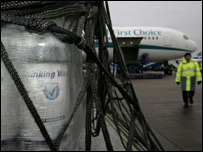 Scottish Water bottles being loaded onto plane