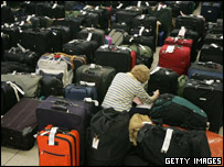 US Airways staff checking luggage at Chicago's O'Hare airport