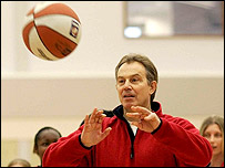 Tony Blair playing basket ball