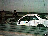 Police around a car used in the attack