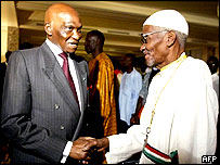 Senegalese President Abdoulaye Wade (L) meets Casamance separatist leader Father Diamacoune Senghor