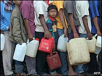 People queue for water