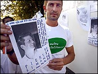 Luke Simon holds a picture of his missing brother Piers