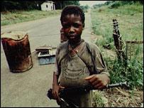 Child in Liberia with gun